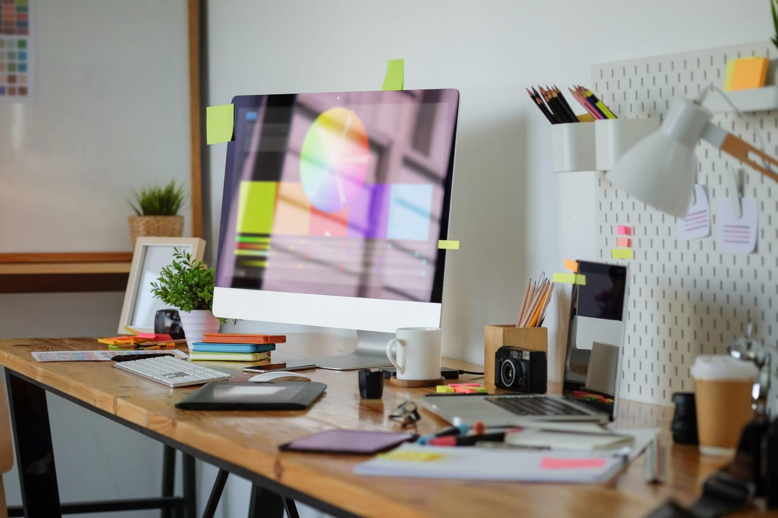 designers desk covered notes aalofts design scaled