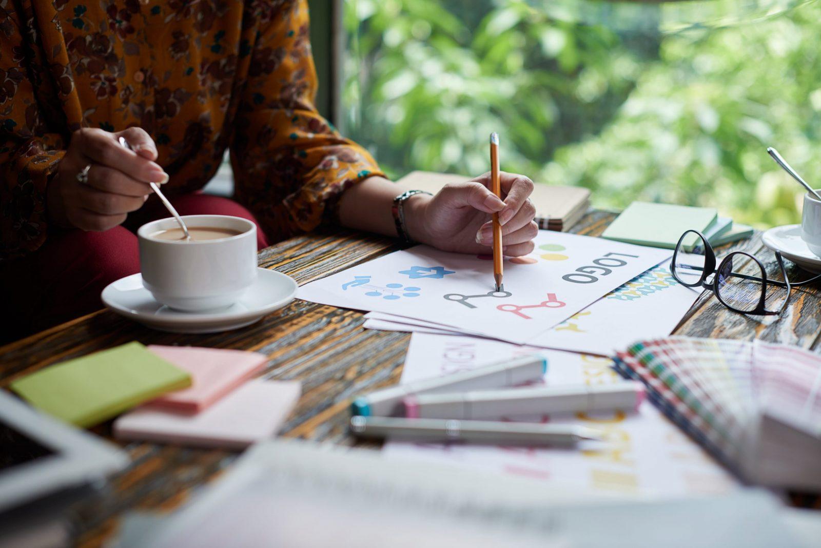 Female Logo Designer At Work